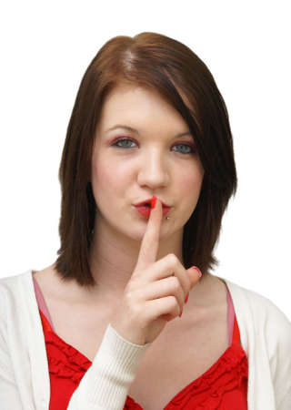 hushed: An attractive woman is shhhing the camera. Stock Photo