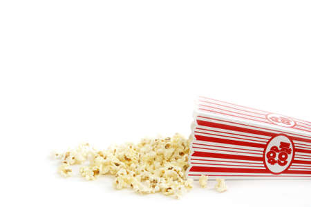 concession: A bucket of popcorn has spilled out.