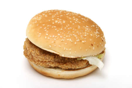 An isolated chicken burger on a sesame seed bun. photo