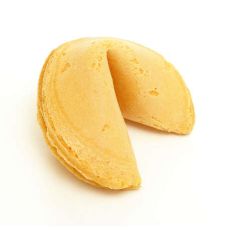 A whole fortune cookie on white background.