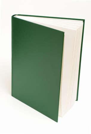 緑の本が、白い背景の上直立しています。