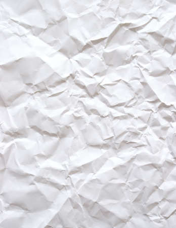 crumpled paper: A piece of plain white bond paper that has been wrinkled. Stock Photo
