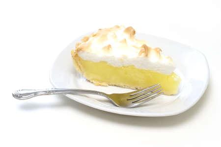 sweet tart: An isolated slice of lemon meringue pie. Stock Photo