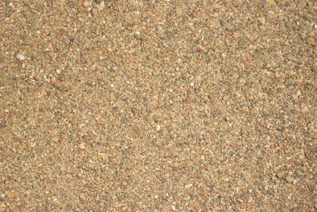 gritty: A macro shot of some brown sand. Stock Photo
