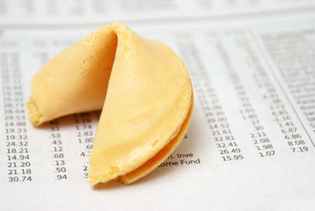 A fortune cookie on the stock investment section of a newspaper. photo