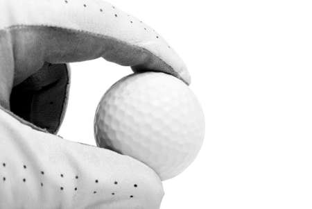 pinches: A golfers hand pinches the ball over white. Stock Photo