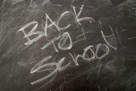 Back to school is written on a chalkboard. photo