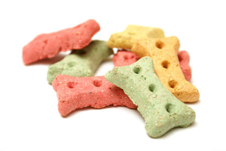 Different coloured dog treats in the shape of a bone. photo