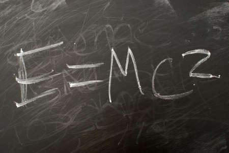 albert: Albert Einsteins famous matematical equation e=mc2 written on a chalkboard. Stock Photo