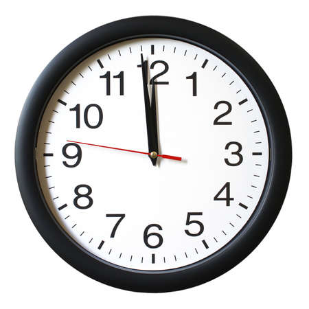 midday: An isolated shot of a clock with one minute left to 12. Stock Photo