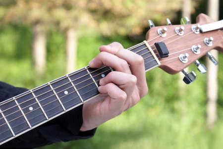 A closeup shot of a young man playing his guitar. Stock Photo - 7229647