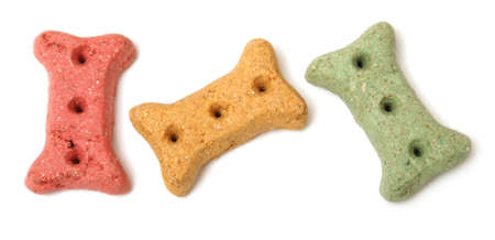 dog health: Three different coloured dog treats in the shape of a bone.