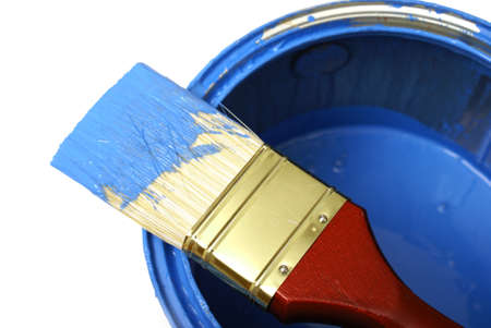 A paint brush and can with the colour blue.