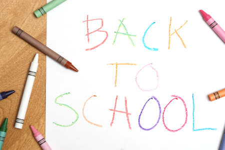 A childish back to school sign written in colorful crayons. Stock Photo - 7510461