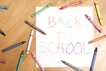 A childish back to school sign written in colorful crayons. Stock Photo - 7510469