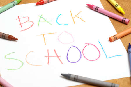 A childish back to school sign written in colorful crayons. Stock Photo - 7510453