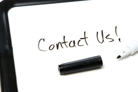 Contact us is hand written in black marker on an office whiteboard. Stock Photo - 7510454