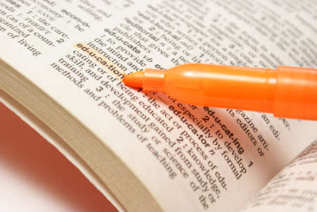 A macro shot of the highlighted word education in the dictionary. photo