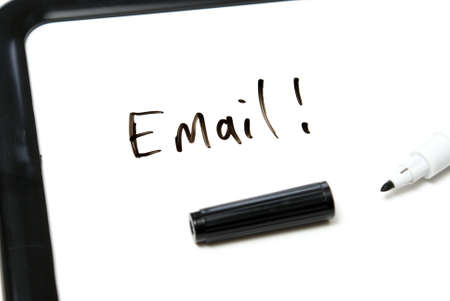 The word Email is hand written in black marker on an office whiteboard. Stock Photo - 7510455