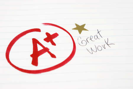 excellent: An A plus is given to a student for great work being achieved. Stock Photo