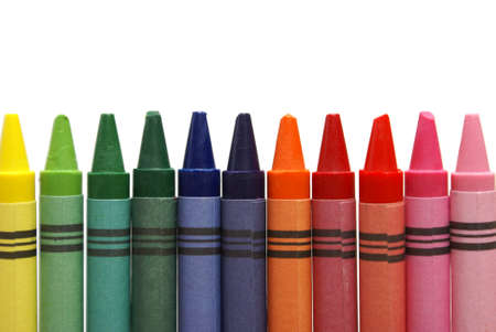 An isolated row of colorful crayons for the young artist. photo