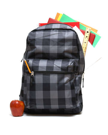 back packs: A backpack full of school supplies ready for the students return to class. Stock Photo