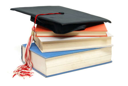 An isolated shot of a Grad hat and books from a high achieving student. photo
