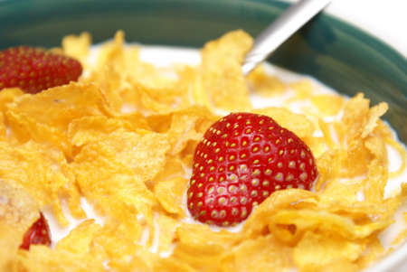 mornings: A bowl of healthy flakes of corn with strawberries at this mornings breakfast table.