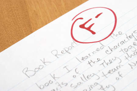A handwritten book report is given an F for poor work. Stock Photo