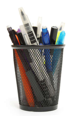 An assortment of pens, markers and more are isolated in a mesh holder. photo