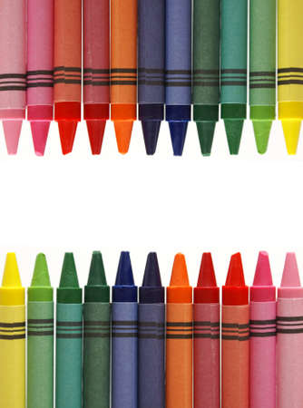 A center frame made from various colored wax crayons, leaving room for your text. Stock Photo - 7617938