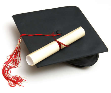 educational: A diploma certificate alongside a grad hat to celebrate the students success.