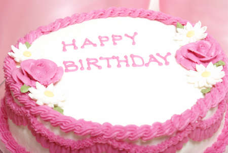 happy occasion: A macro shot of a pretty pink cake for any aged females special day. Stock Photo
