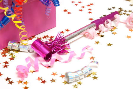 noise maker: A pink noise maker with confetti on a white background. Stock Photo