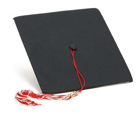 An isolated shot of a graduation hat. photo