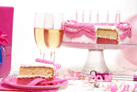 A party scene with lots of cake and champage.