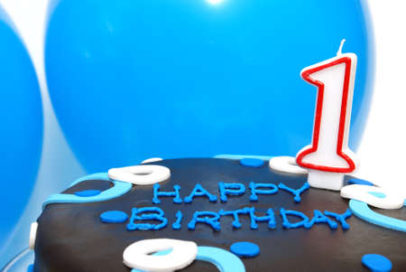 first day: A cake decorated in blue has a number one candle to celebrate that one year mark.
