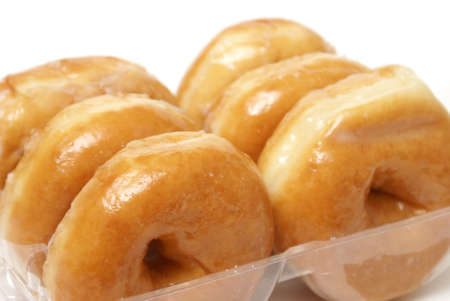 A half dozen of glazed donuts in a pack.