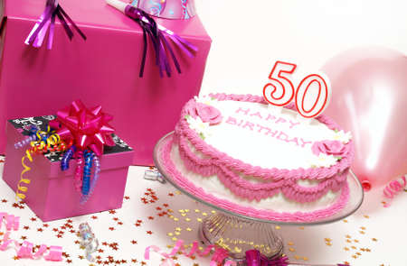 A 50th birthday cake for to celebrate someones special day. photo