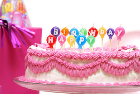 Unlit candles that spell out happy birthday to celebrate someones special day. photo
