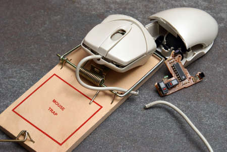 A conceptual photo involving a computer mouse and trap to give meaning to ideas such as hacking, errors, and many others. photo