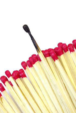 One burnt match stick stands out from the rest for a conceptual difference. Stock Photo - 8589889