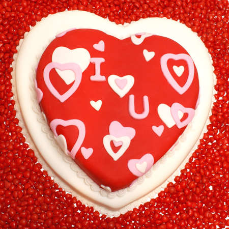 A cake in the shape of a heart for Valentines, Anniversaries, and Birthdays. photo