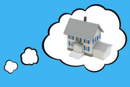 Thought bubbles surround a tiny house to represent the dream of home ownership.