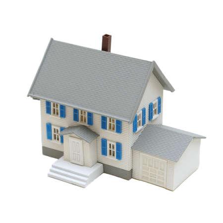 A miniature house isolated on a white background. Reklamní fotografie - 8679825