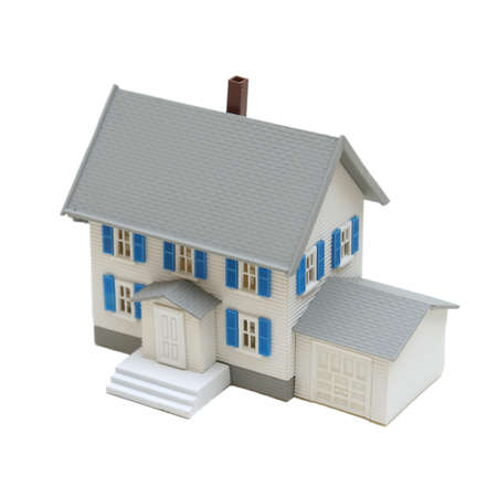 A miniature house isolated on a white background. Standard-Bild