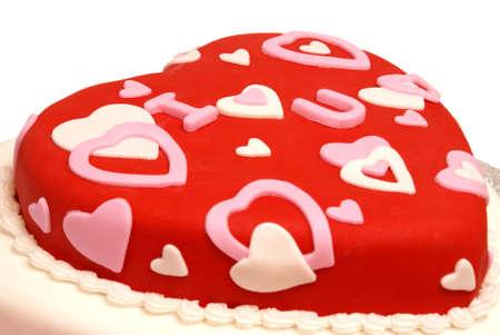 Een cake in de vorm van een hart voor Valentijnsdag, verjaardagen en verjaardagen. Stockfoto