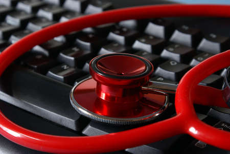 A stethoscope on a keyboard for medical conceptions.