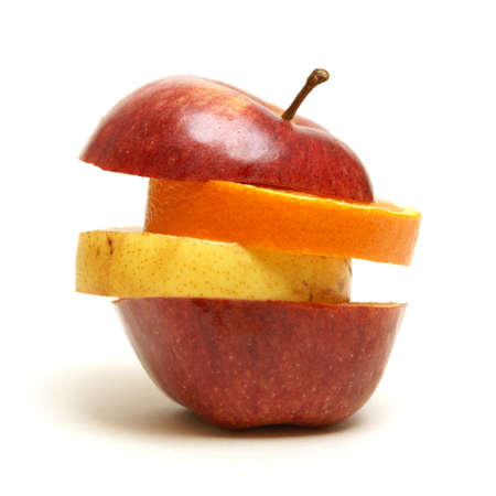 A variety of fruit arranged to make a unique apple shape. photo