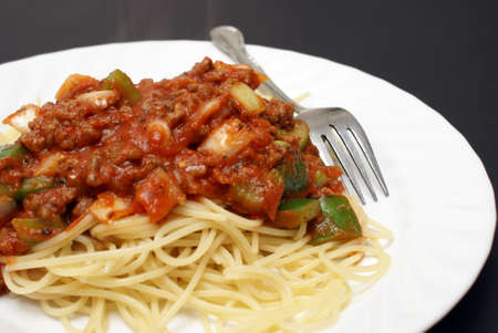 A freshly served plate of hot spaghetti. Stock Photo - 9172926